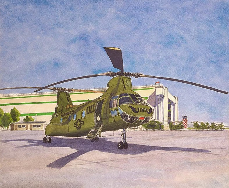 CH-46 Sea Knight Helicopter parked on ramp at MCAS Tustin in front of Blimp Hangar