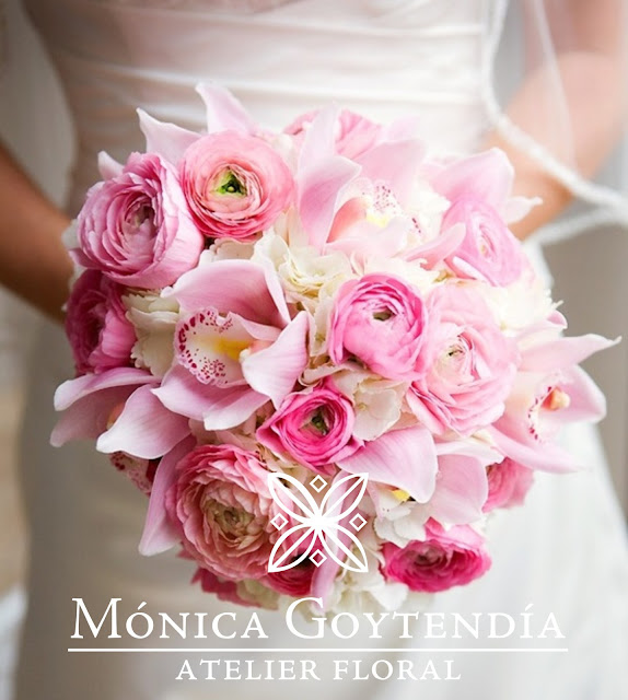 Classic white and pink bouquet with cymbidium orchids, ranunculuses and hydrangeas