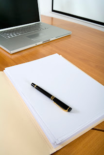image of laptop and paper