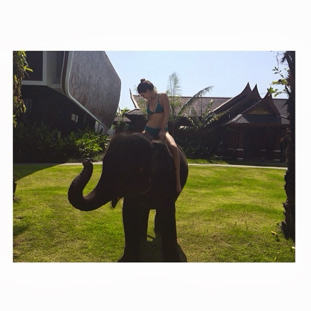 Kylie Jenner riding an Elephant in a Green Bikini during her trip in China