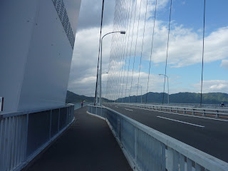 Looking along the road deck of the cable-stayed Tatara bridge, from the shimanami kaido bikeway
