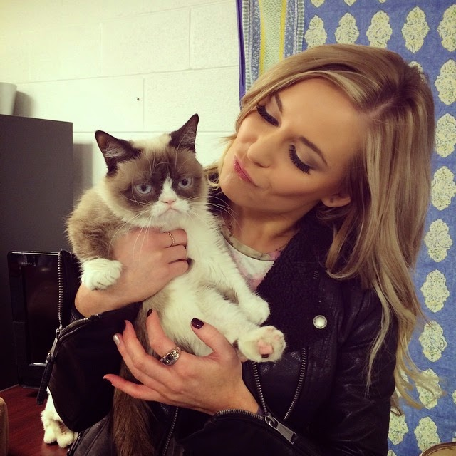 Renee Young Playing with The Grumpy Cat.