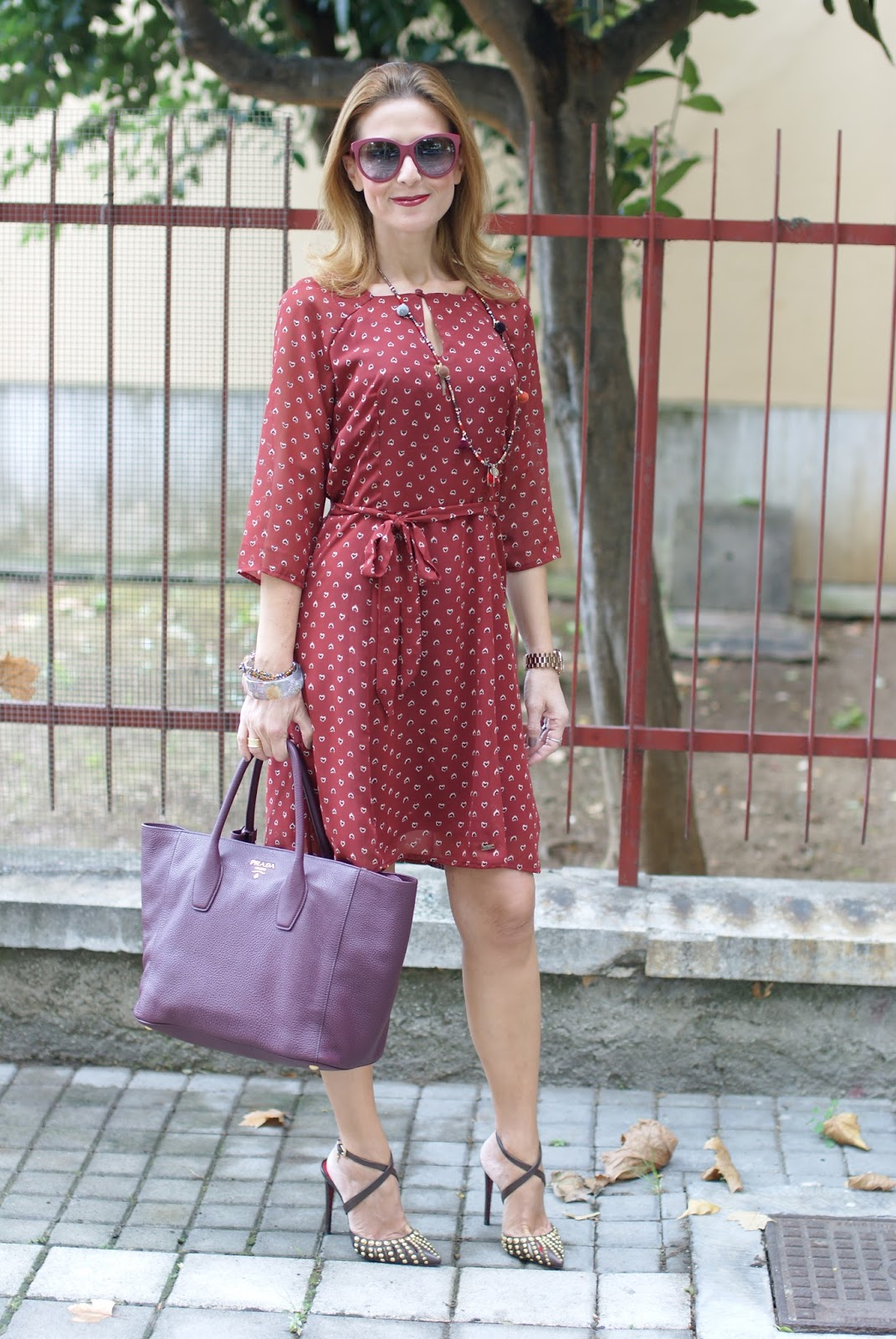 Mismash rust dress, studded heels and burgundy Prada tote on Fashion and Cookies fashion blog, fashion blogger style