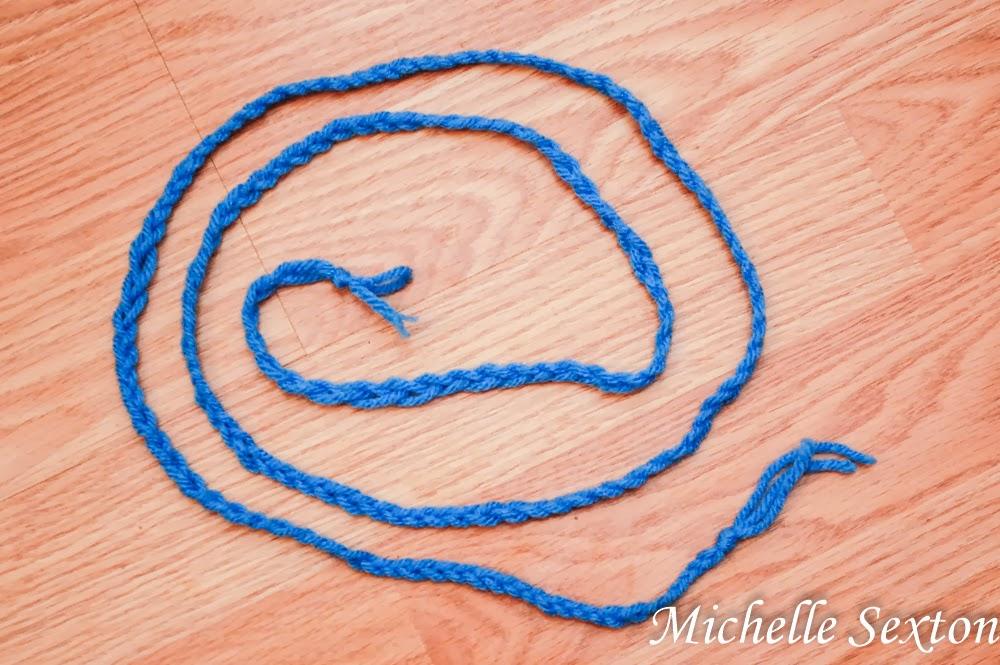 braid 3 strands of yarn together