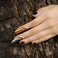 usa news corp, CHRIS BROWN, yellow gold diamond cross pendant, TAIO CRUZ, black and white diamond tennis bracelet in Kenya, best Body Piercing Jewelry