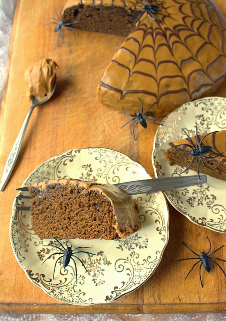 Treacle spice cake made topped with Speculoos spread and a chocolate cobweb