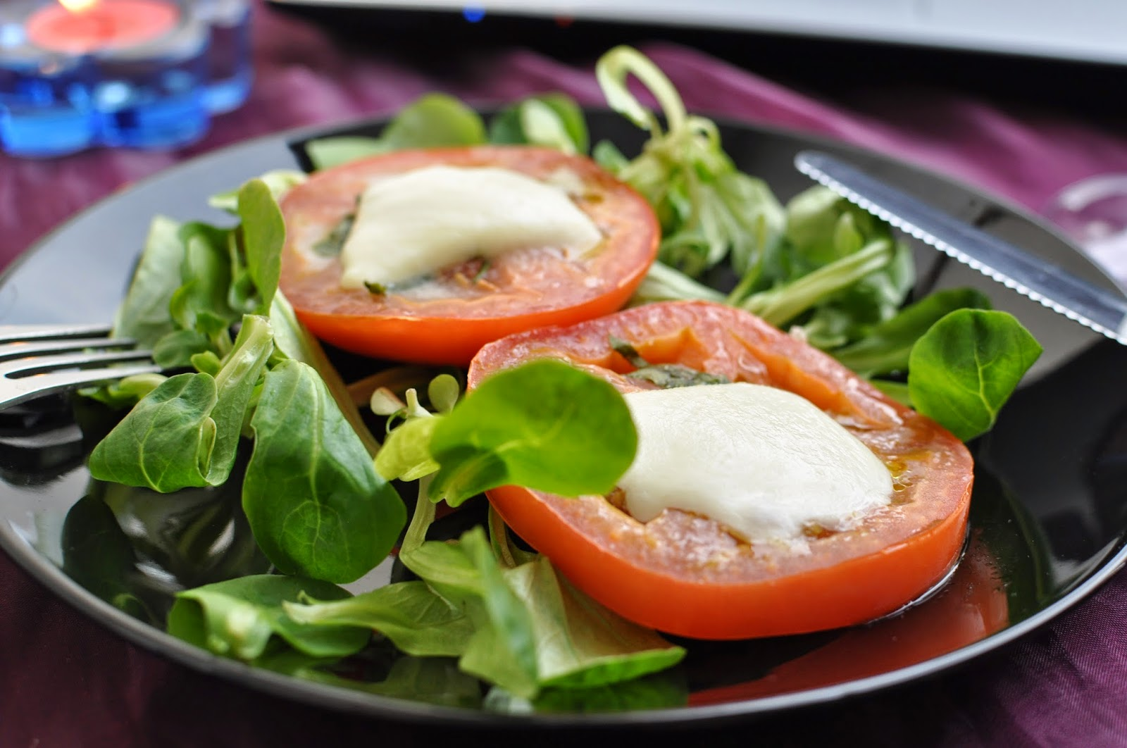 bruschetta tomato slices on a bed of salad
