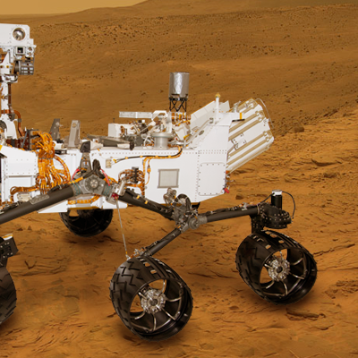 Mars Science Laboratory (MSL) Curiosity. The rover will explore Mars in late 2012 looking for evidence of life and learning more about the planet. Artistic side view over photo-composite taken by Pathfinder. NASA + JPL + Ren@rt, 2011.