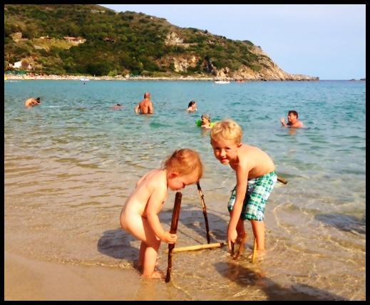 naked toddler at beach