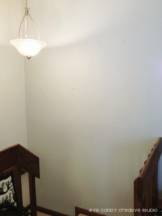 before photo of empty wall of gallery wall area, blank space of gallery wall
