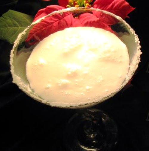 Coconut Snowball Martini: Classic festive cocktail of cream, vanilla vodka, coconut rum and cream of coconut served in a martini glass