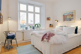 cozy scandinavian bedrooms 1 554x371 Dekorasi kamar tidur untuk cuaca dingin