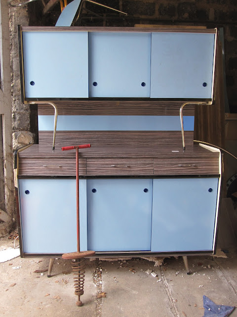 a pogo stick and  blue / brown formica kitchen cabinet, we were hesitant but 30€ , it's for nothing  1950 50s 1960 60s 1970 70s