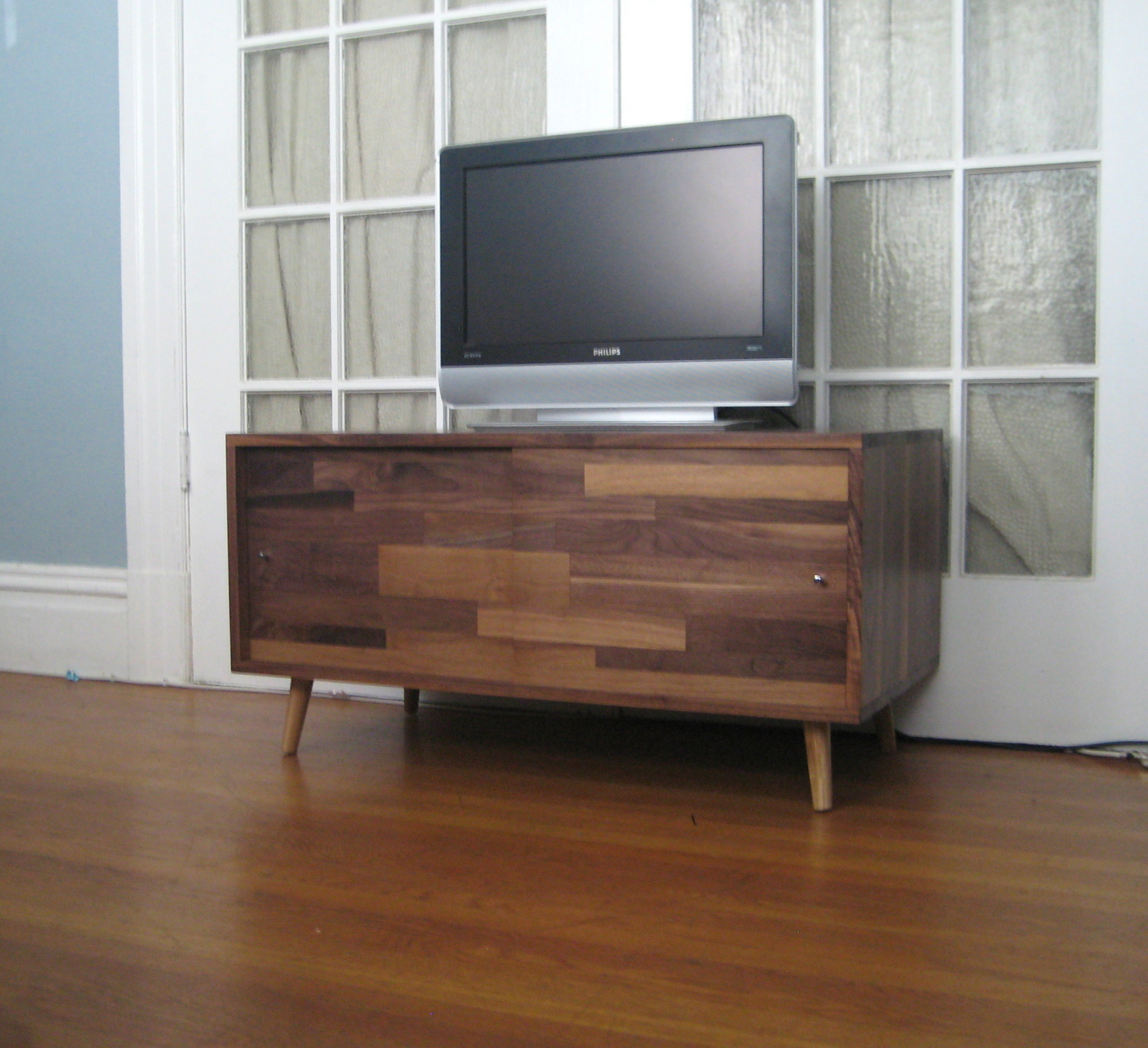 As The Saw Blade Turns Customizable Media Console W Sliding Scrap Panel Doors