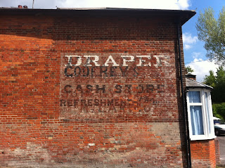 Multiple ghost signs in Easterton, Wiltshire