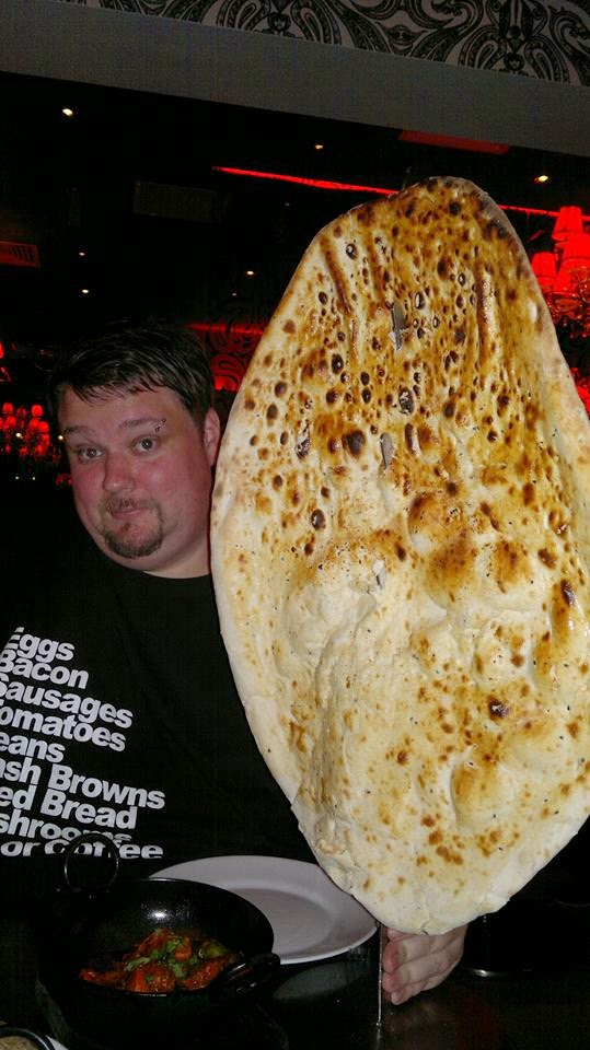 Ben Viveur pictured with extremely large naan bread