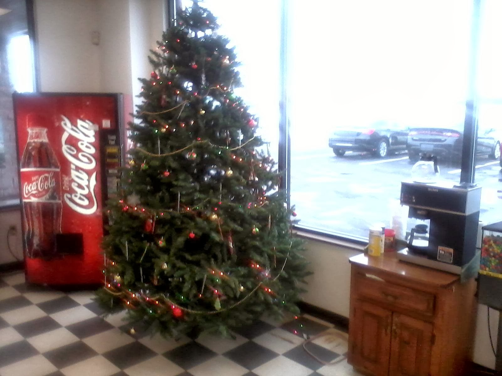 FX in the Bay Employees Decorate Showroom Tree