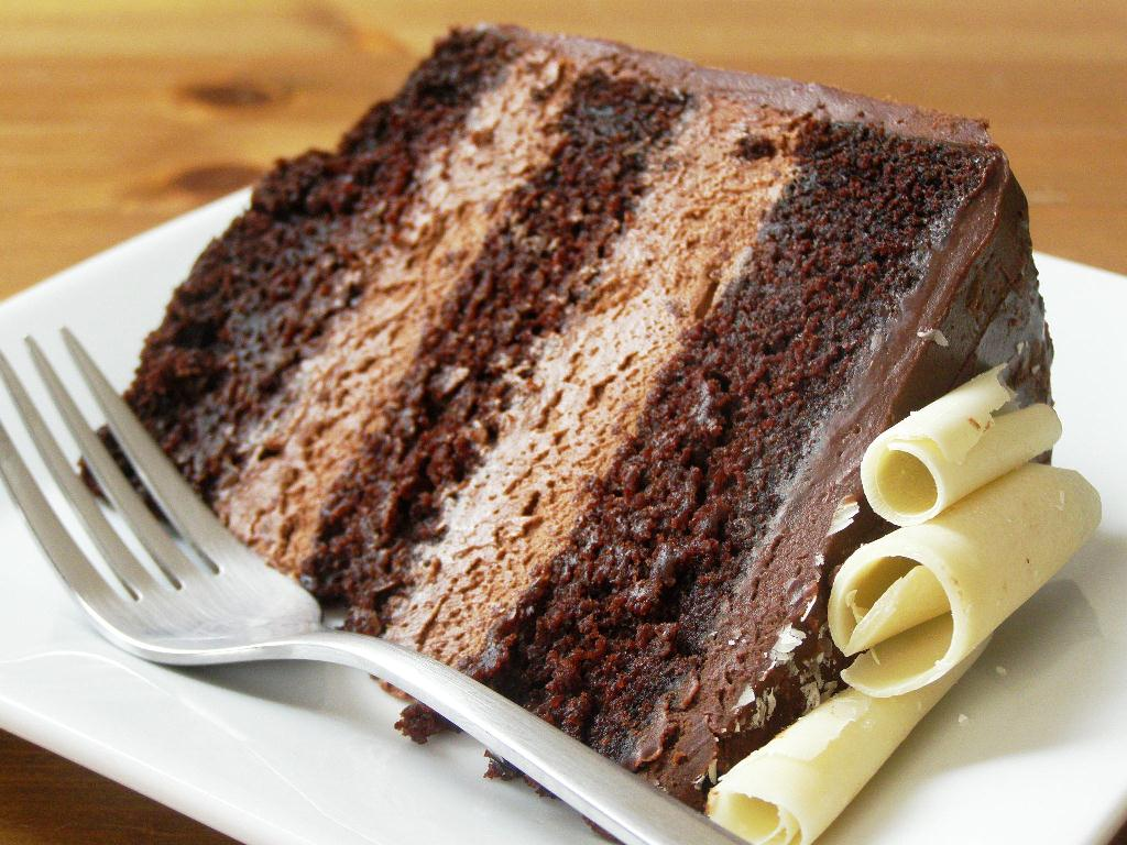 Slice of Vegan Double Chocolate Mousse Layer Cake