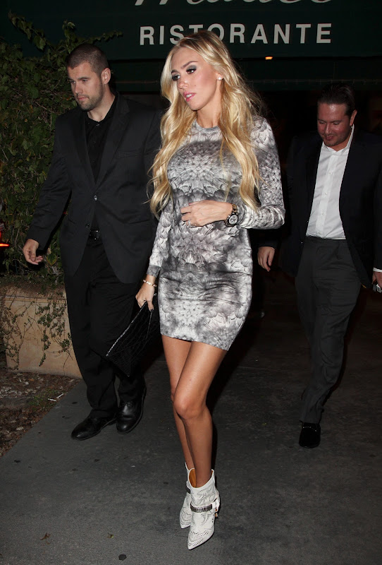 Petra Ecclestone leggy in a short dress