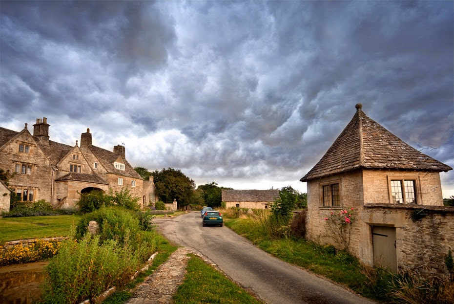 Cotswold village of Fulbrook with old buildings and dramatic sky