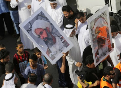 Protesters demanding freedom for jailed Shiite cleric Nim al-Nimr