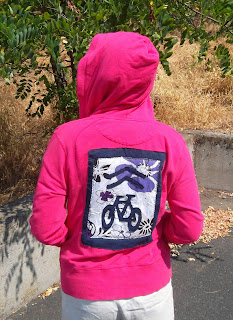 "Jacket back: Share-the-road ""Sharrow"" design on hoodie jacket"