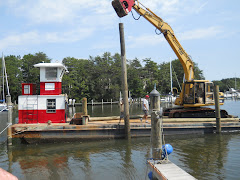 Replacing the 3 pilings Irene took. What a treat to watch skilled guys operate big heavy machinery!