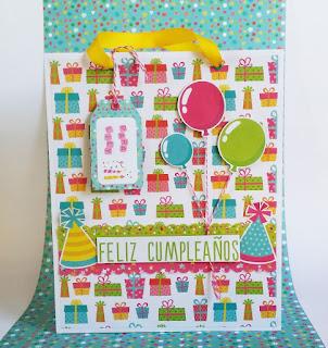 http://anitaysumundo.com/bolsa-para-regalo-scrapbook/