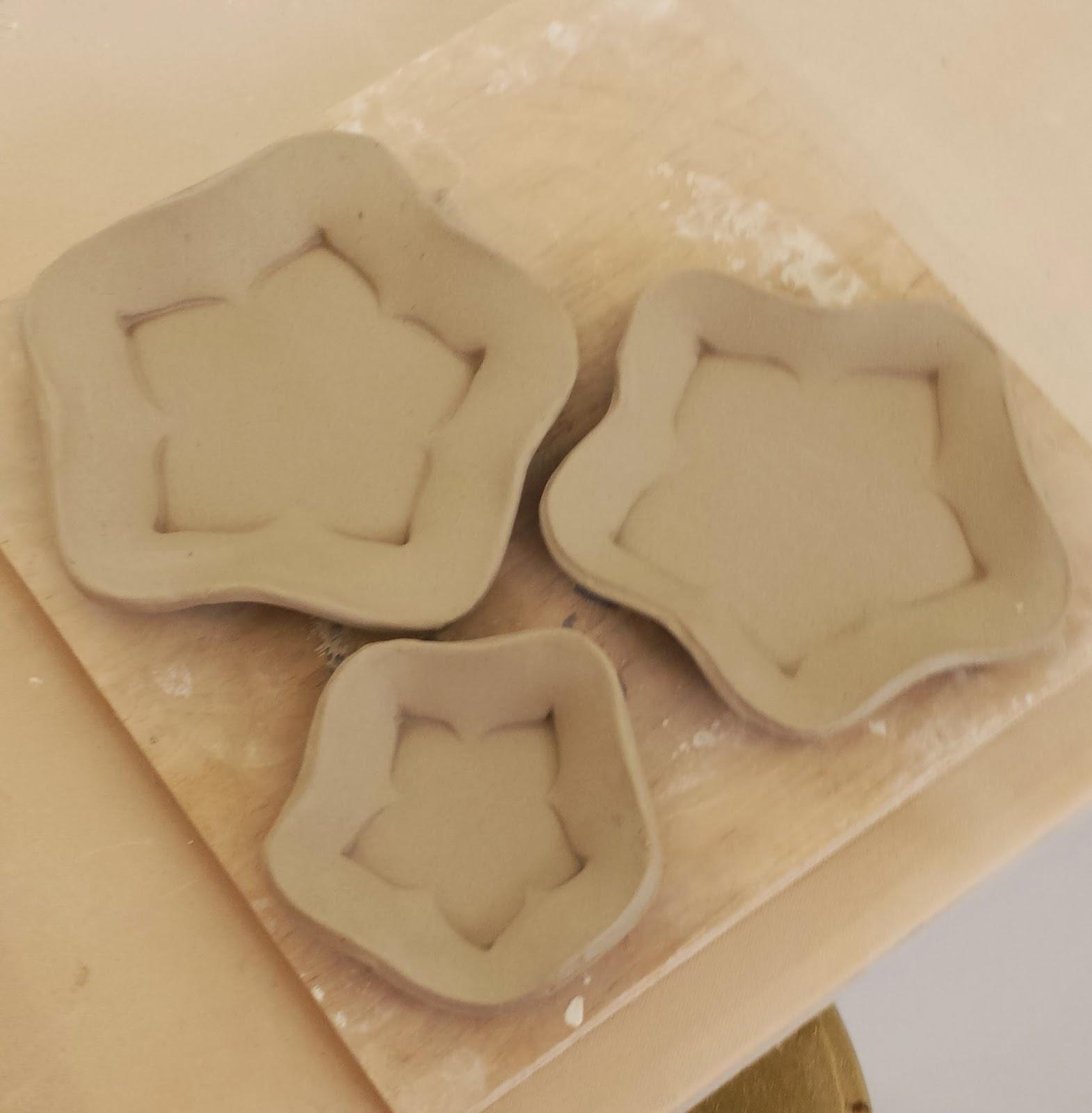 Slab-made ceramic pottery plates, pressed into foam to create the shape.