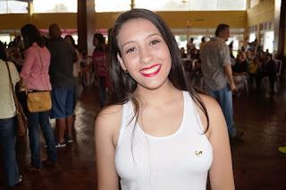 A aluna Melissa Nascimento fala da alegria de participar do evento