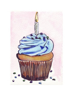 yellow cupcake with blue icing and one candle