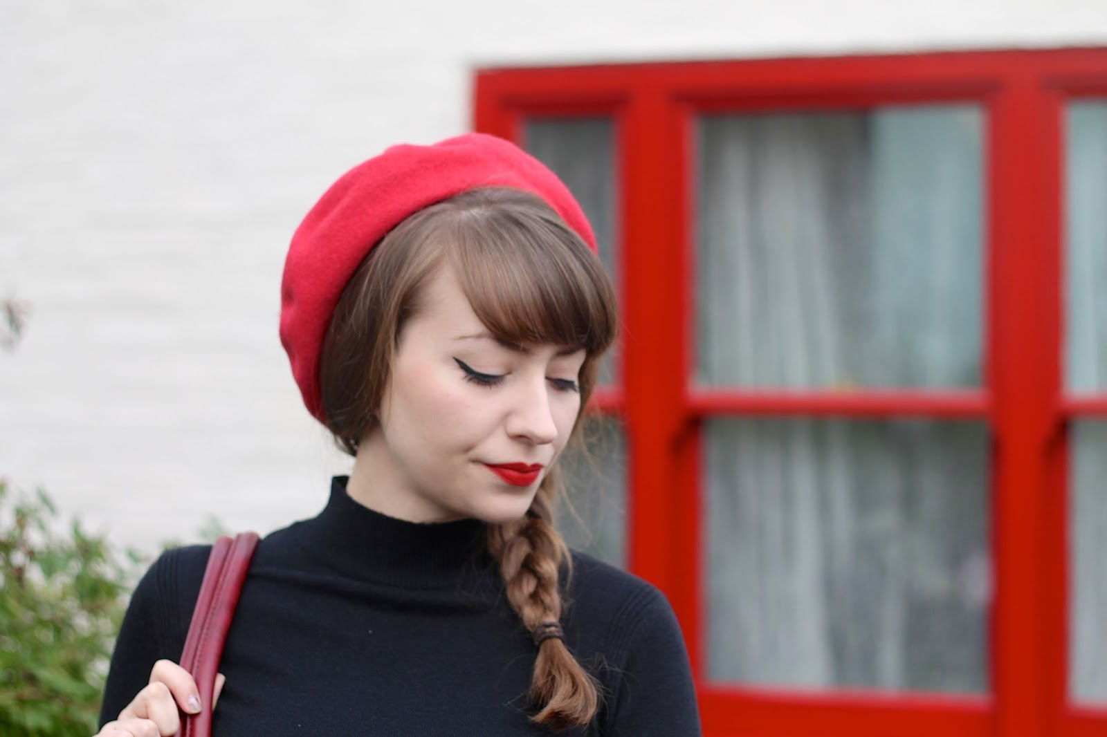 Red beret with black turtleneck