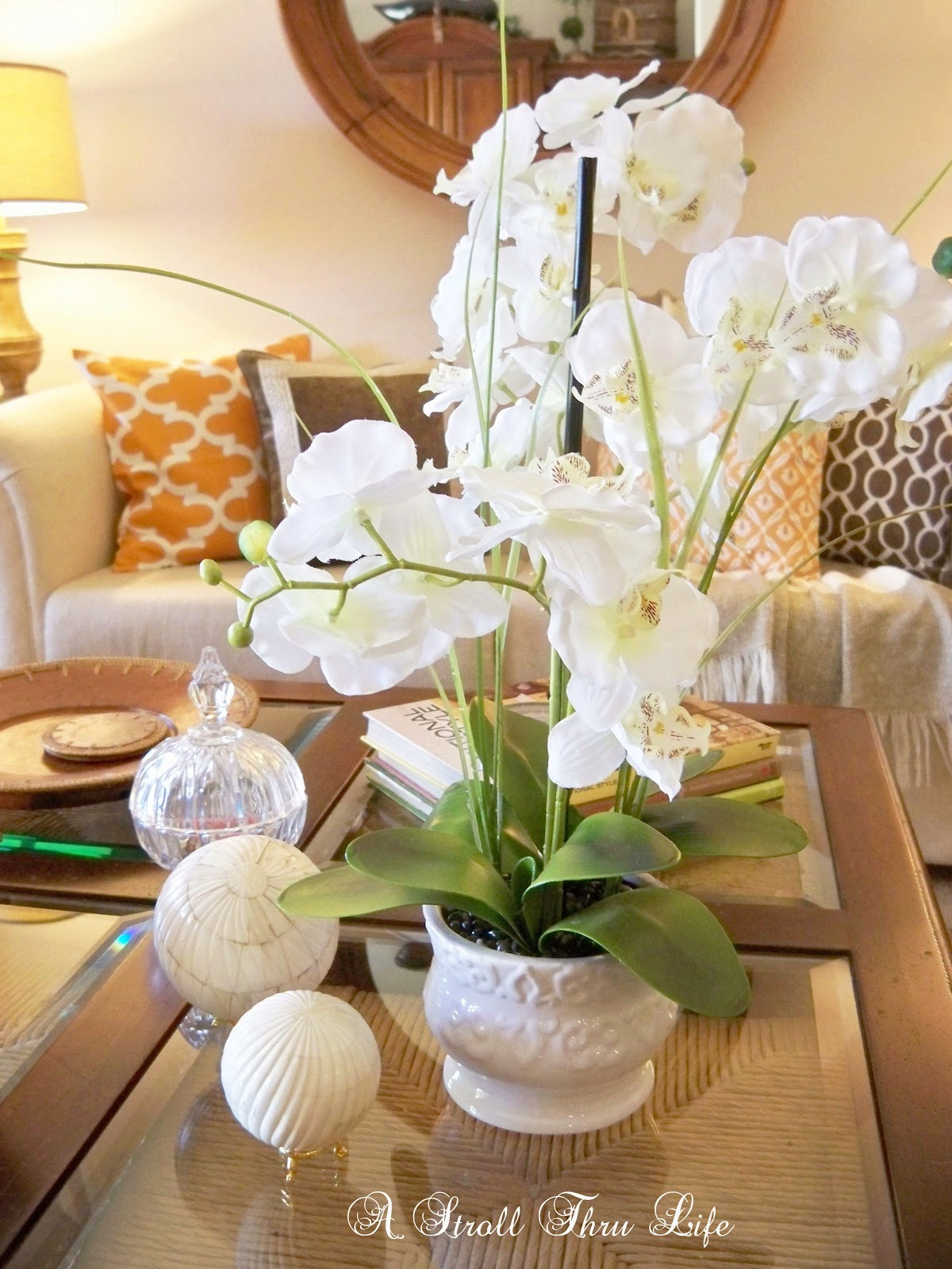 a pretty white orchid started a whole chain of events i thought the pillows and decor needed to be light and bright too: day orchid decor
