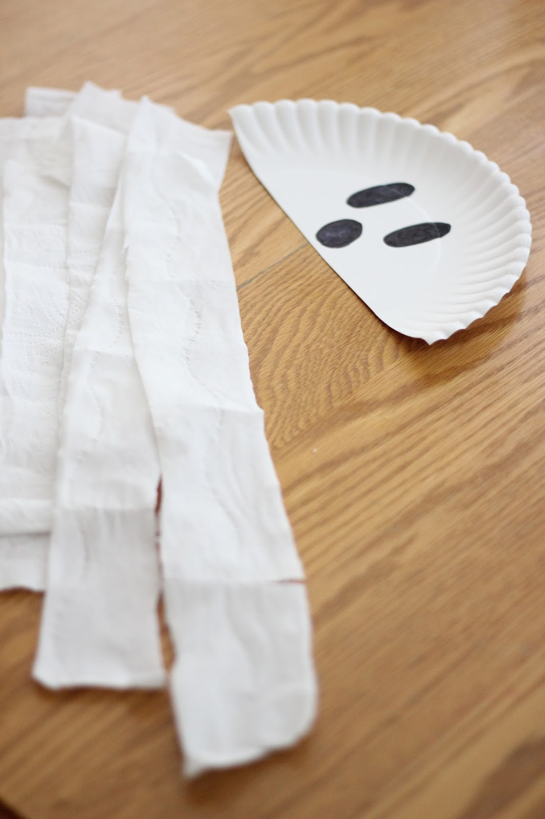 Next draw a ghost face on your paper plate half. & Toddler Approved!: Paper Plate Ghost Craft for Preschoolers