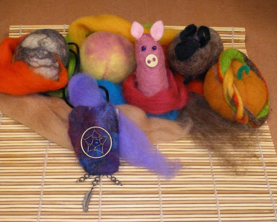 Small animal figures made out of balls of felted wool