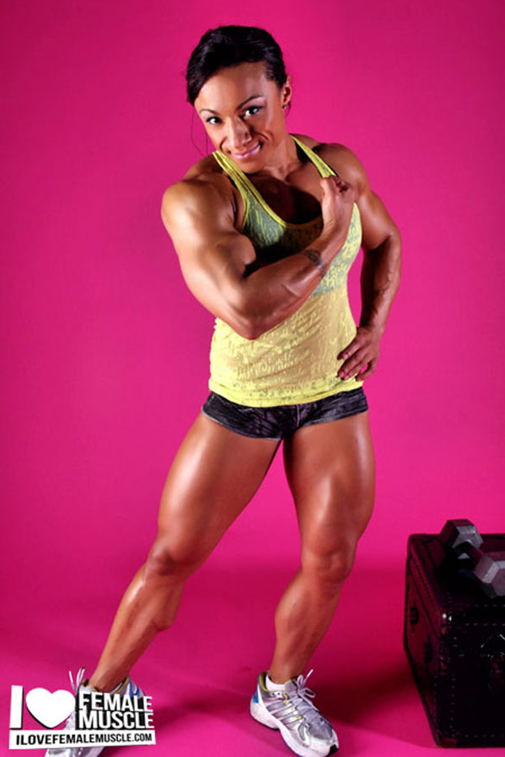 Karen Garrett Flexing Her Bicep And Muscular Legs