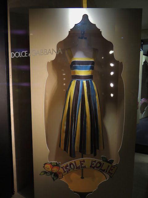 Striped Dolce & Gabbana sundress in visual merchandising display, Rome