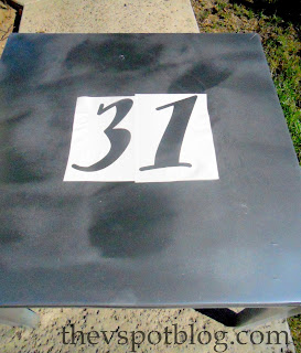 painting a 31 on a Halloween  table
