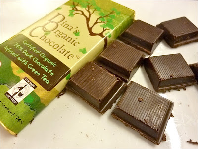 with a delicious piece of Dina's organic dark chocolate with Green Tea