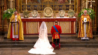 The weds, kneeling at the Abbey altar. YouTube 2011.