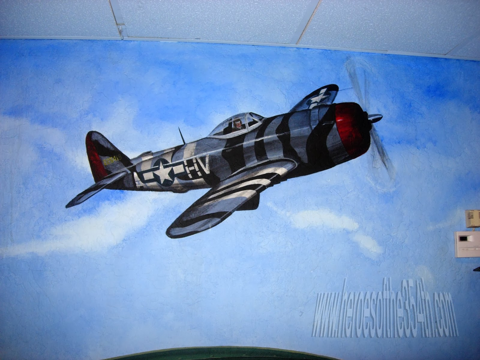 the 354th fighter group and some wwii memorabilia and wall murals at anzio landing restaurant in mesa az