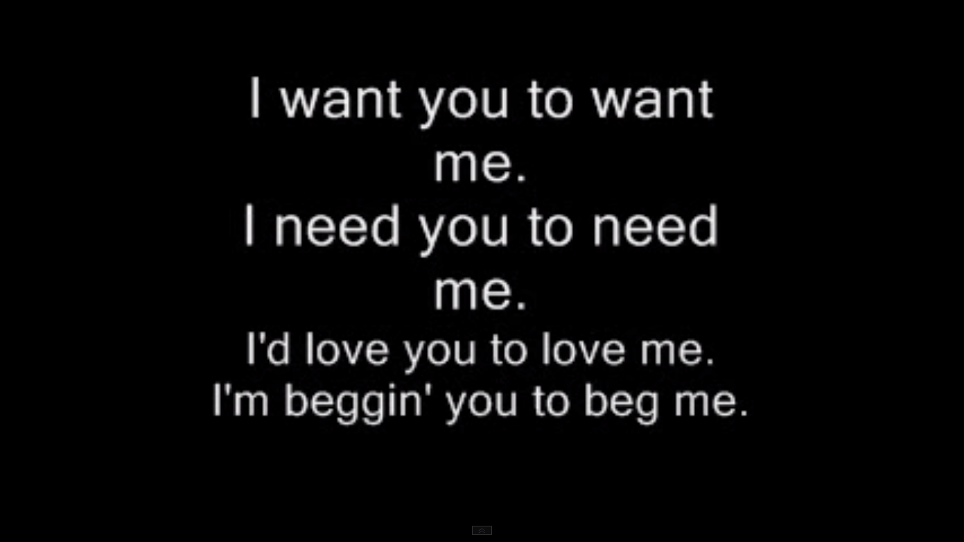 cuadro negro con letras blancas con la letra I want you to want me.