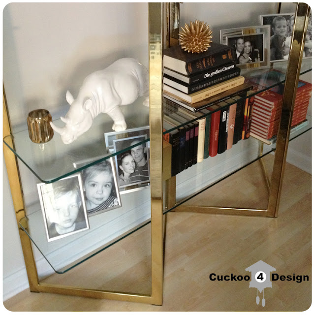 brass and glass shelf