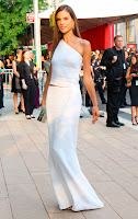 Alessandra Ambrosio stunning in a white dress and backless top