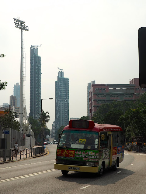 Skyscrapers and a minibus in Mong Kok, Kowloon, Hong Kong