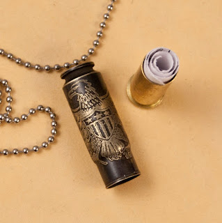 Etched bullet casing pendant with secret cubby from Dazzlez.