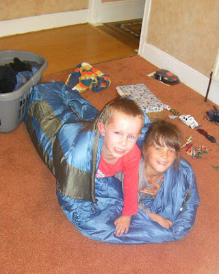 2 kids in a sleeping bag