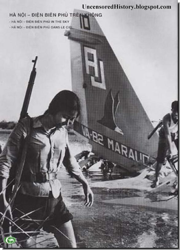 North Vietnamese woman militia passes downed B 52 bomber