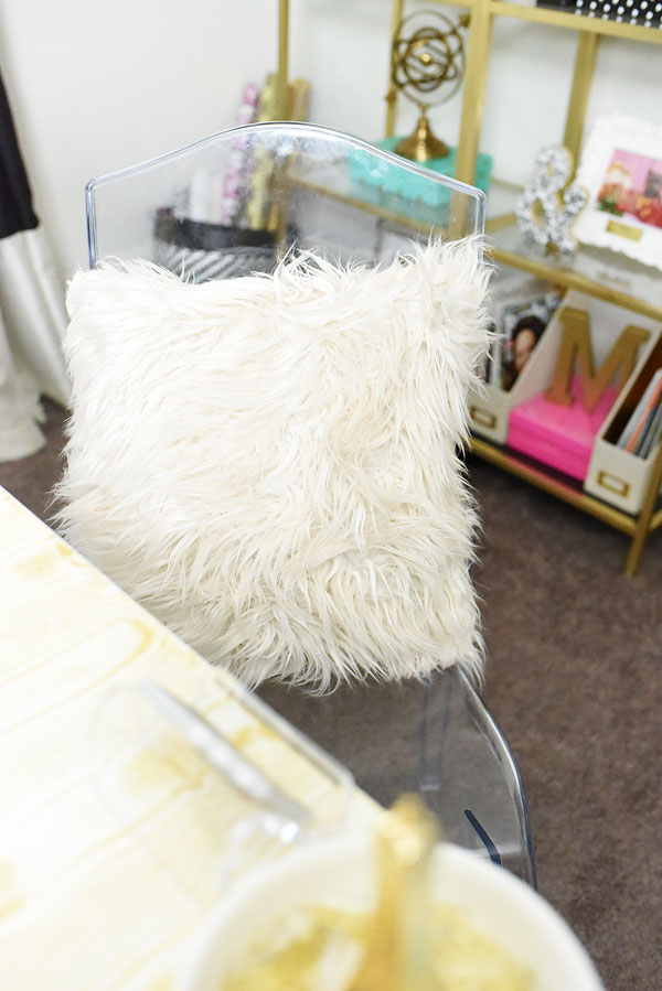 The arctic fur pillow from the BHG line at Walmart is perfect for any space that needs a dash of girly glam. Only $15.97 at Walmart.