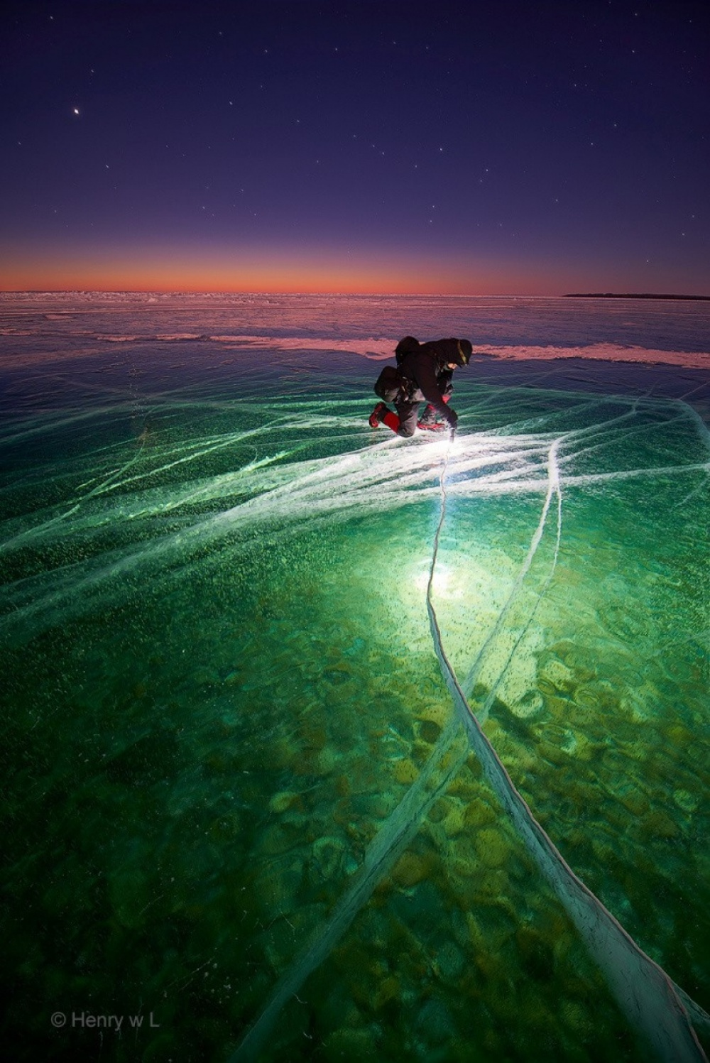The 100 best photographs ever taken without photoshop - Man with Flashlight on Ice creates Beauty